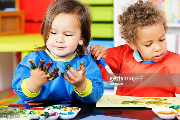 Close-up Of Little Boys Enjoying Art And Craft