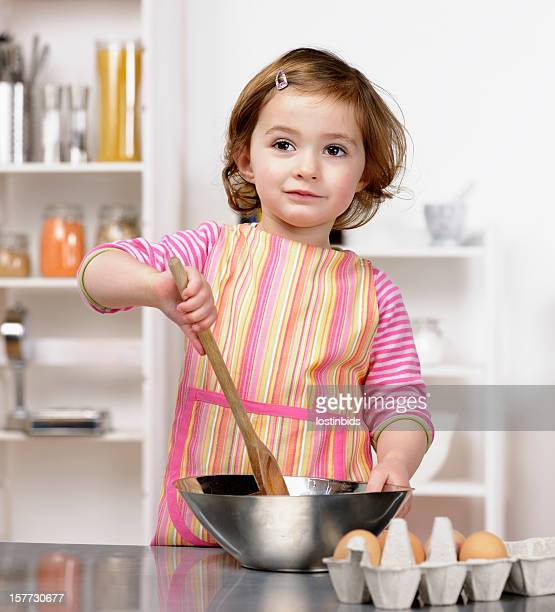 Close-up Of Little Girl Contemplating While Preparing Food