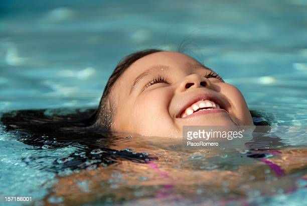Closeup of  little girl swimming in a pool