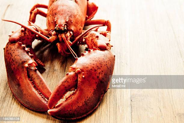 Close-up of lobster on wooden table