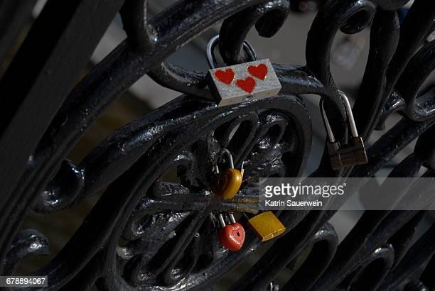 Close-up Of Love Locks On Metal Grate