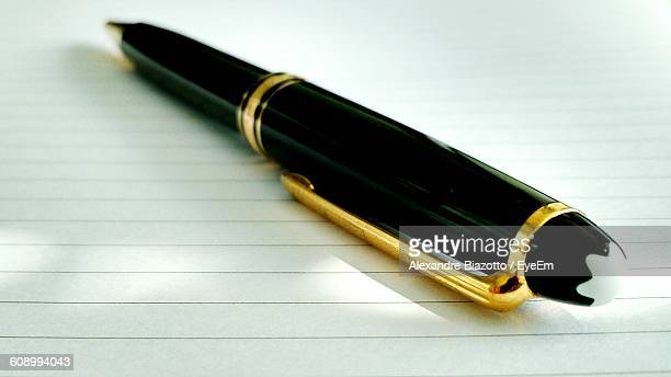 Close-Up Of Luxury Pen On Paper