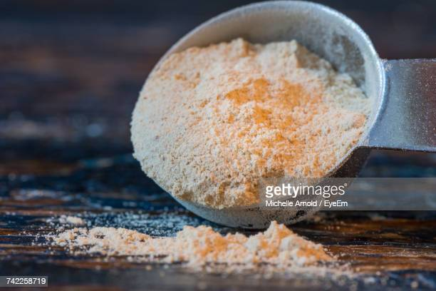 Close-Up Of Maca Powder In Spoon On Table