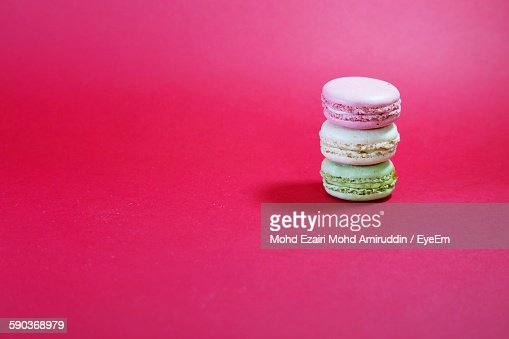 Close-Up Of Macaroon Stack Against Pink Background