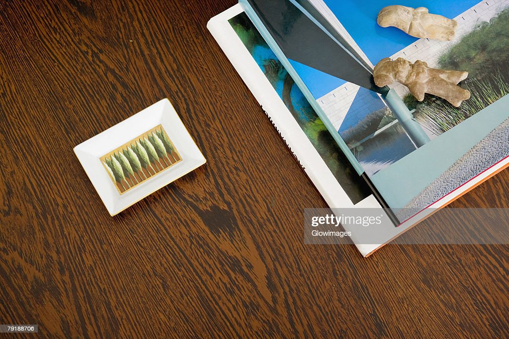 Close-up of magazines and an ashtray on a table : Stock Photo