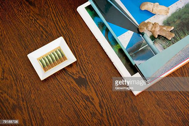 Close-up of magazines and an ashtray on a table