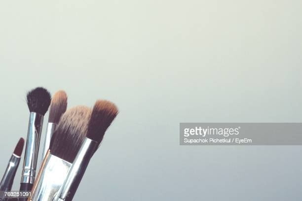 Close-Up Of Make-Up Brushes Against White Background