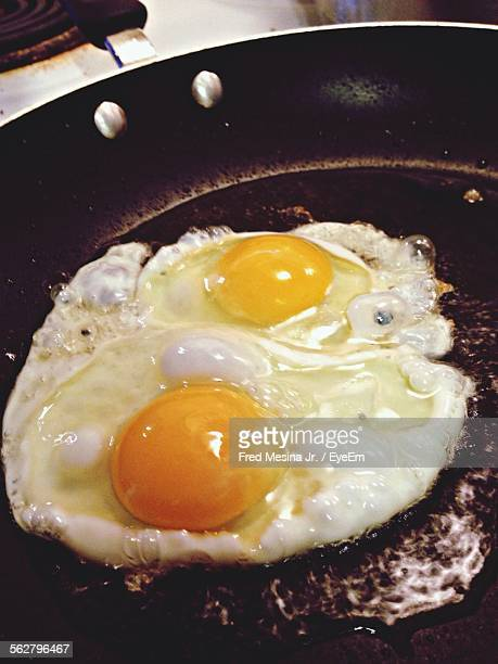 Close-Up Of Making Egg In Frying Pan
