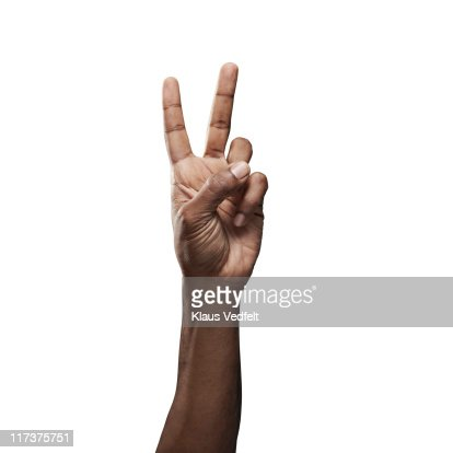 Close-up of male hand doing 'peace' sign : Foto de stock