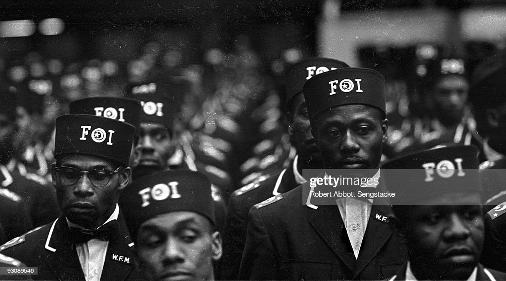 Close-up of male Nation of Islam attendees, in the uniform of the Fruit of Islam, as they attend Saviour's Day (held on February 26) celebrations, Chicago, Illinois, mid 1960s.