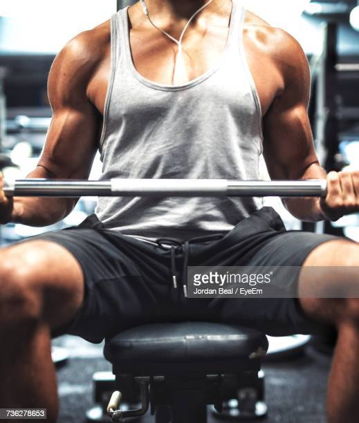 Close-Up Of Man Exercising In Gym