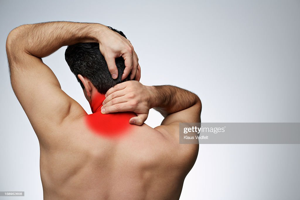 Close-up of man having neck pain (rear view) : Stock Photo