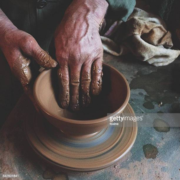 Image result for a person making pottery images