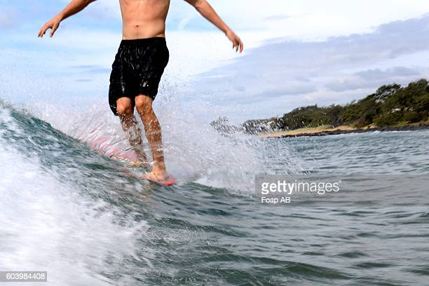 Close-up of man surfing on the wave