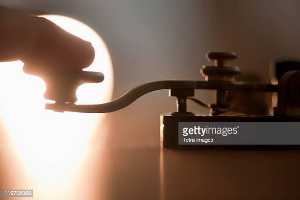 Close-up of man using telegraph key