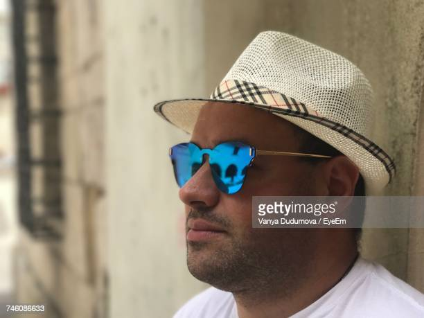 Close-Up Of Man Wearing Sunglasses And Hat