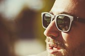 Close-Up Of Man Wearing Sunglasses Outdoors