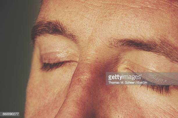 Close-Up Of Man With Closed Eyes