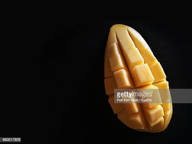 Close-Up Of Mango Against Black Background