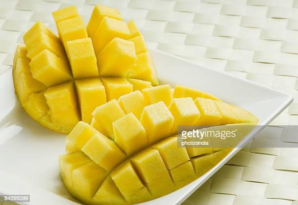 Close-up of mango slices cut into segments