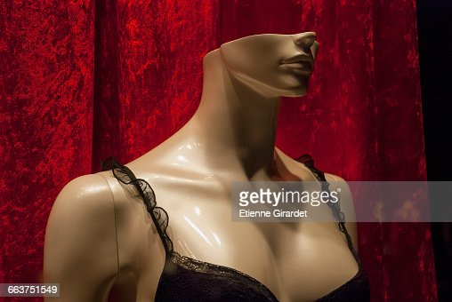 Close-up of mannequin wearing black bra for retail display at store
