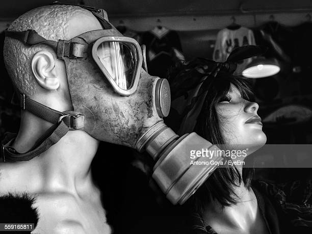 Close-Up Of Mannequins Wearing Gas Mask