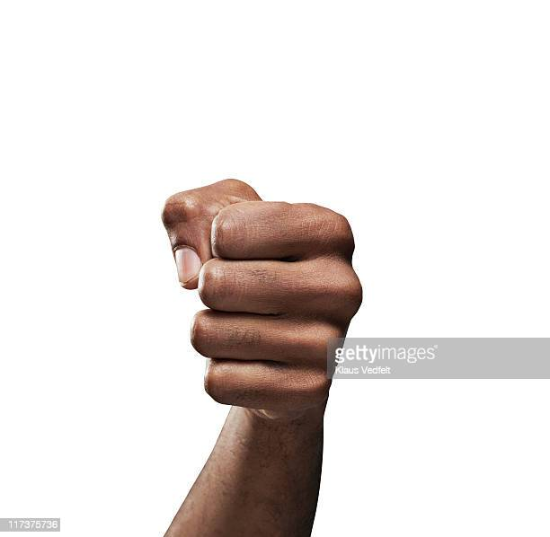 Close-up of man's fist on white background