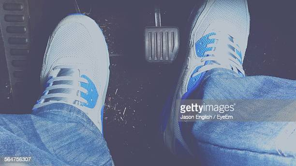 Close-Up Of Mans Foot Pressing Cars Pedal