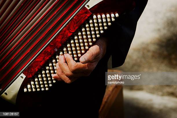 Close-up of Man's Hand Playing Vintage Accordion