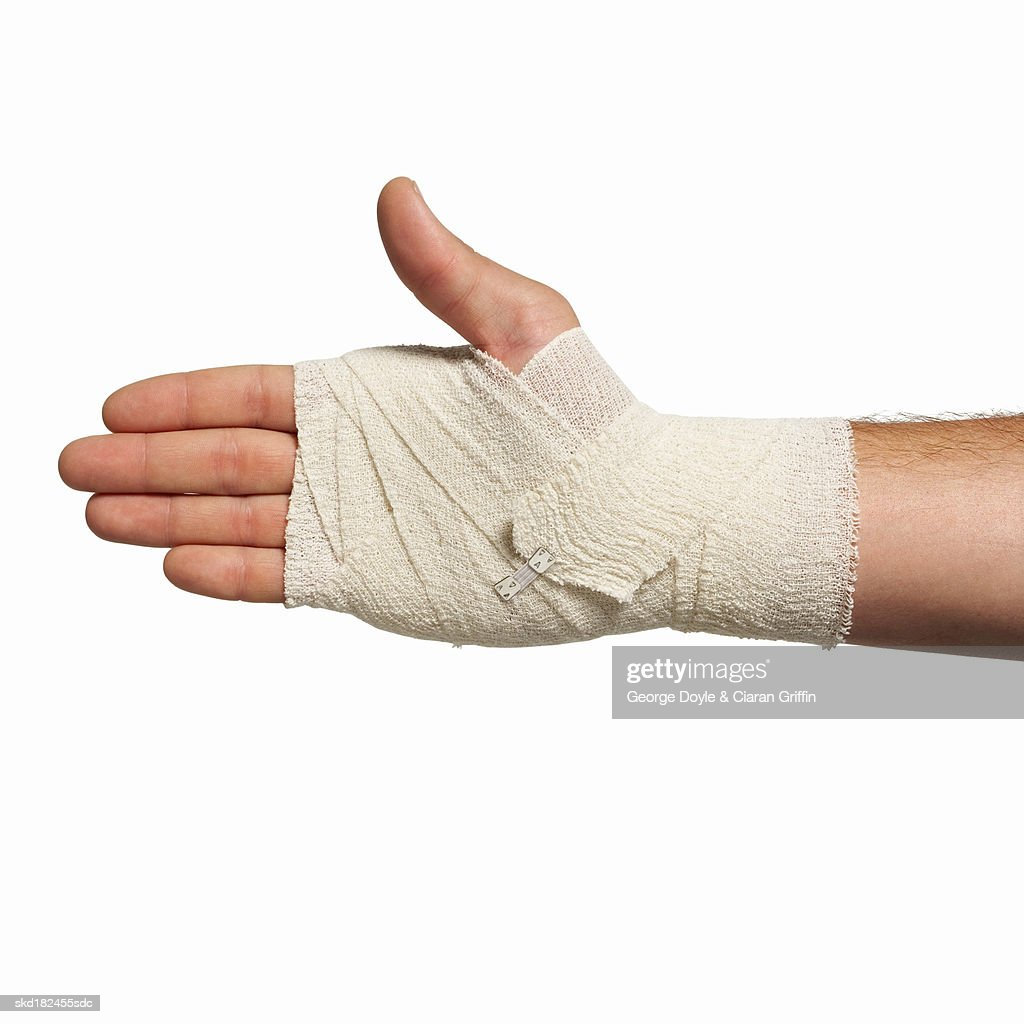 Close-up of man's hand wearing bandage
