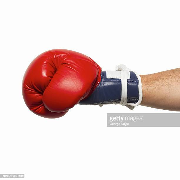 Close-up of man's hand wearing boxing glove