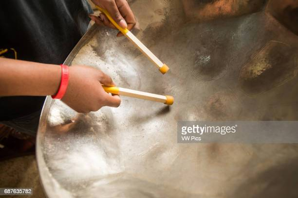 Closeup of man's hands playing a steel drum in Baltimore Maryland