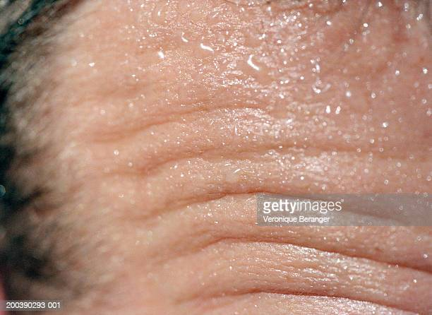 Close-up of man's wrinkled forehead