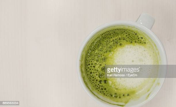 Close-Up Of Matcha Coffee On Table
