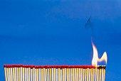 Close-up of matchsticks burning
