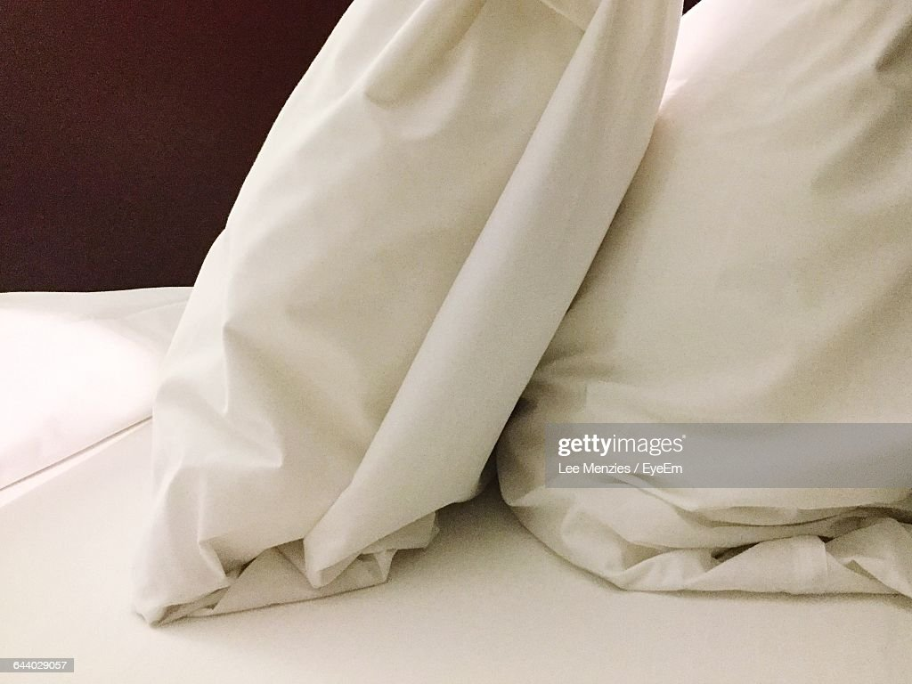 Close-Up Of Mattress On Bed