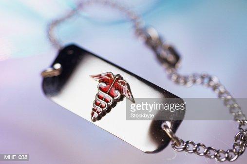 Close-up of medical alert bracelet : Stock Photo