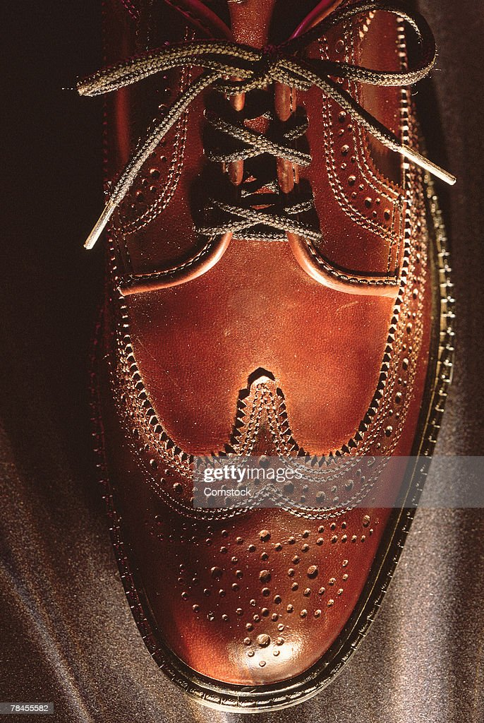 Close-up of men's brown shoe