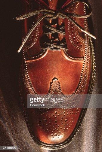 Close-up of men's brown shoe