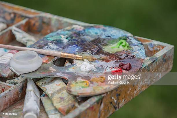 Close-up of messy painting palette in park