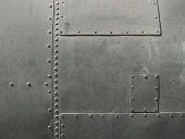 Close-up of military detail in a dark gray color