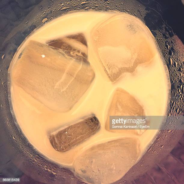 Close-Up Of Milkshake In Glass With Ice Cube