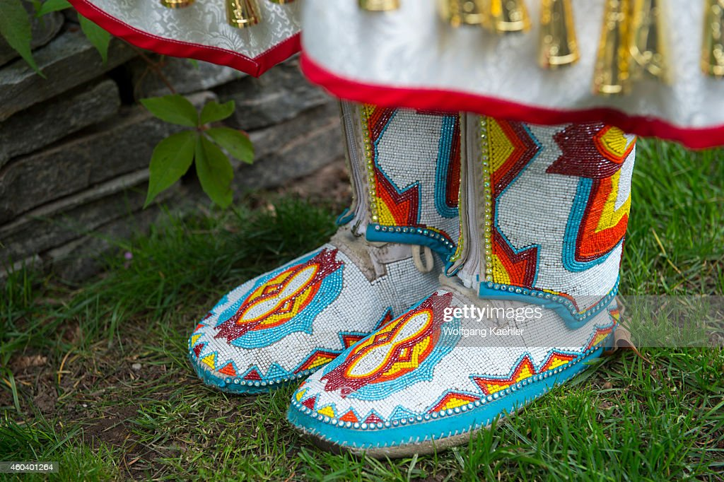 Closeup of moccasins of a young Salish woman in a jingle dress at Averill's Flathead Lake Lodge a dude ranch near Kalispell Montana United States