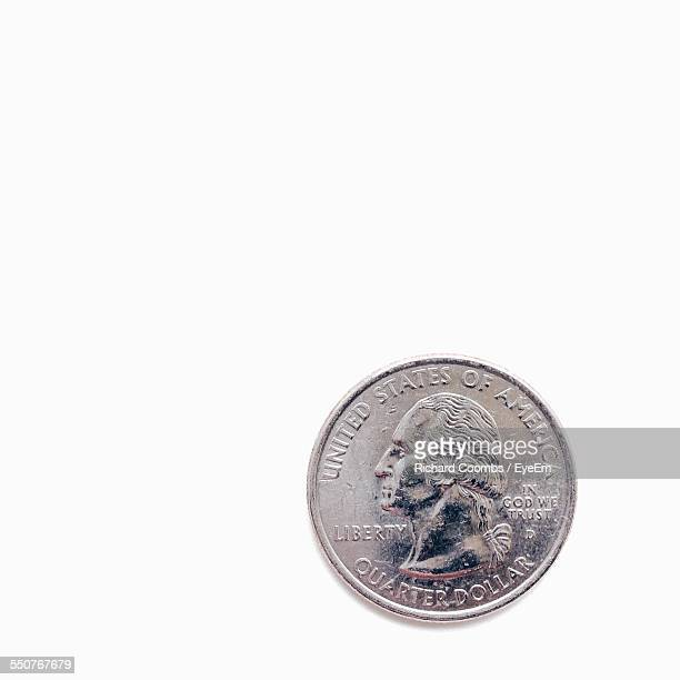 Close-Up Of Money Coin Over White Background