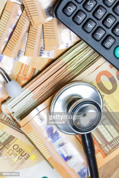 Close-Up Of Money, stethoscope and calculator. Medical concept