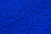 Pile of powdered blue pigment.