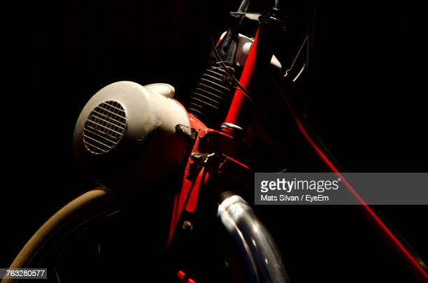 Close-Up Of Motorcycle Against Black Background