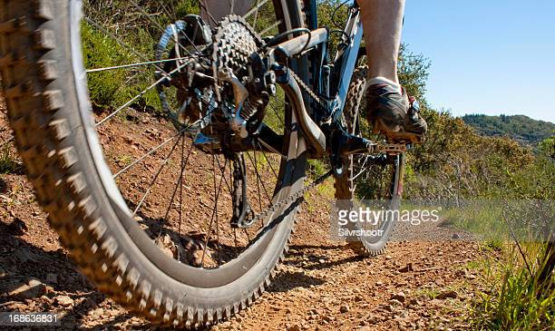 Closeup of mountain bike on a trail.