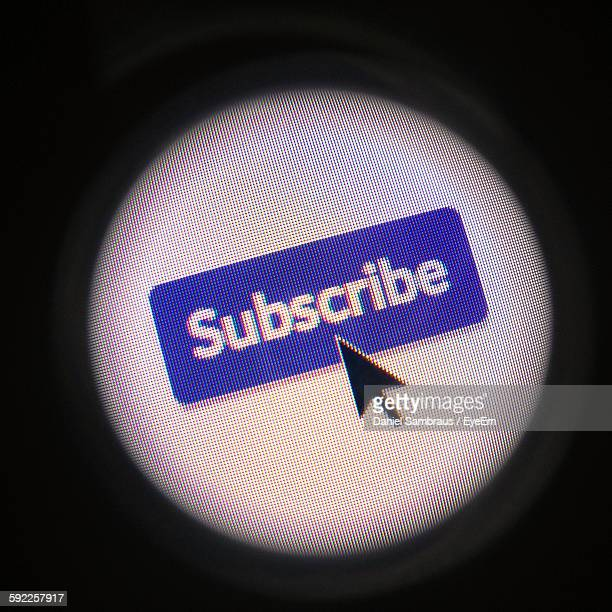 Close-Up Of Mouse Pointer On Subscribe