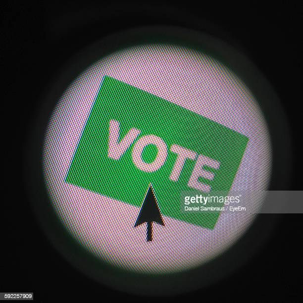 Close-Up Of Mouse Pointer On Vote Text